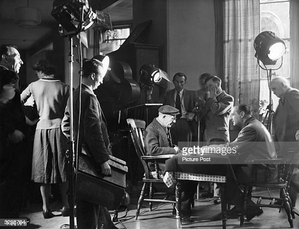 Cecil Parker rehearses a scene for the Ealing studios production of 'One Sinner' directed by Basil Dearden Title One Sinner Studio Ealing Director...