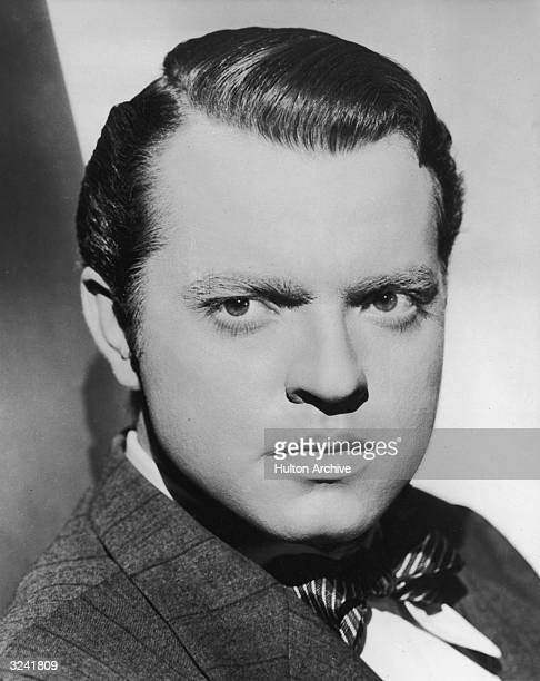 Closeup portrait of American actor and filmmaker Orson Welles wearing a jacket and bow tie