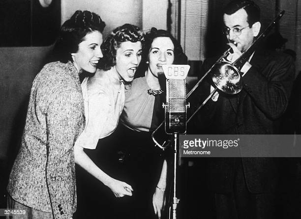 EXCLUSIVE American singers and siblings LaVerne Andrews Maxene Andrews and Patti Andrews of the Andrews Sisters sing into a CBS microphone while...