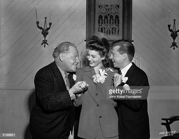 Former child actor Mickey Rooney competes for the attentions of his wife beautiful actress Ava Gardner with his father Joe Yule on their wedding day