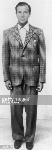 Fulllength image of American gangster Bugsy Siegel who began syndicatecontrolled gambling in Las Vegas Nevada Siegel wears a houndstooth blazer...