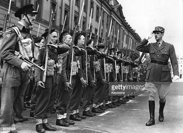 General Charles de Gaulle inspecting members of the newly formed Free French command unit at Wellington Barracks.
