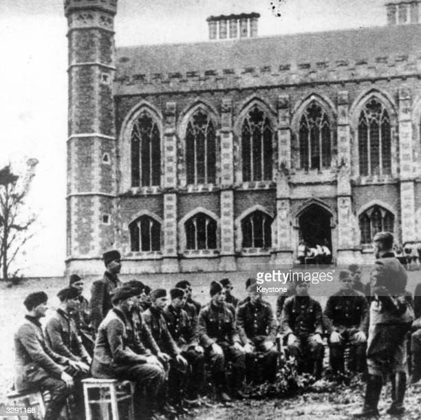 German soldiers are given a lecture in the grounds of Victoria College, Jersey, where they are billeted during their occupation of the Channel...