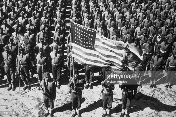 Group view of the soldiers of the 41st Corps of Engineers an AfricanAmerican army battalion standing in formation and holding the American flag Fort...