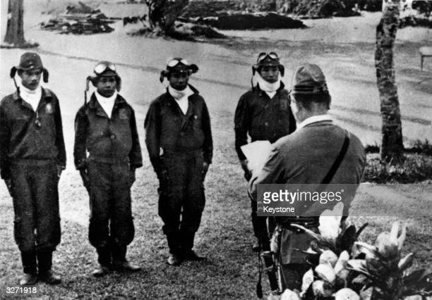 Japanese 'Kamikaze' pilots stand to attention before a commanding officer