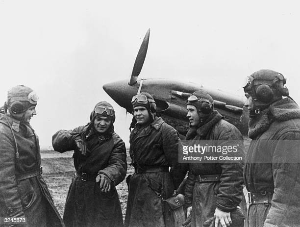 Soviet pilot Victor Radkevitch gestures as he tells his fellow pilots how he forced a German Luftwaffe airplane down behind Soviet lines USSR