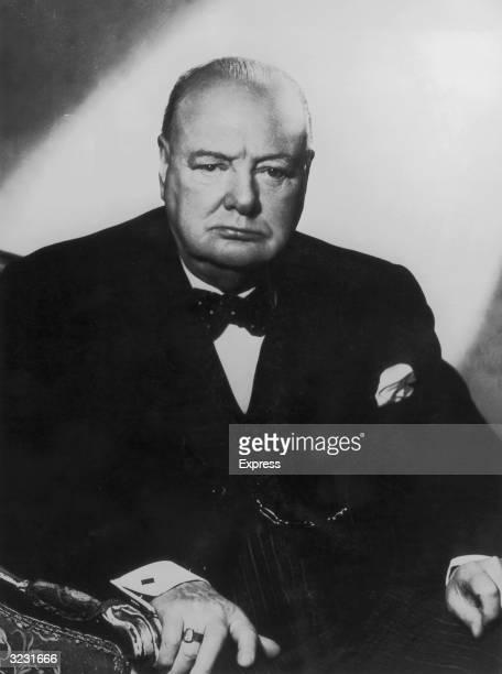 Studio portrait of British prime minister Winston Churchill sitting in an armchair.