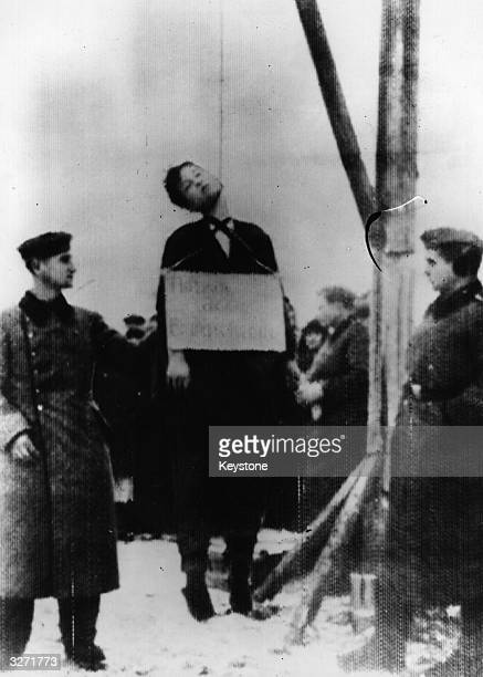 The corpse of a young girl from the village of Petrichyechevo near Moscow swings in the air The Germans beat and tortured her but she remained silent...