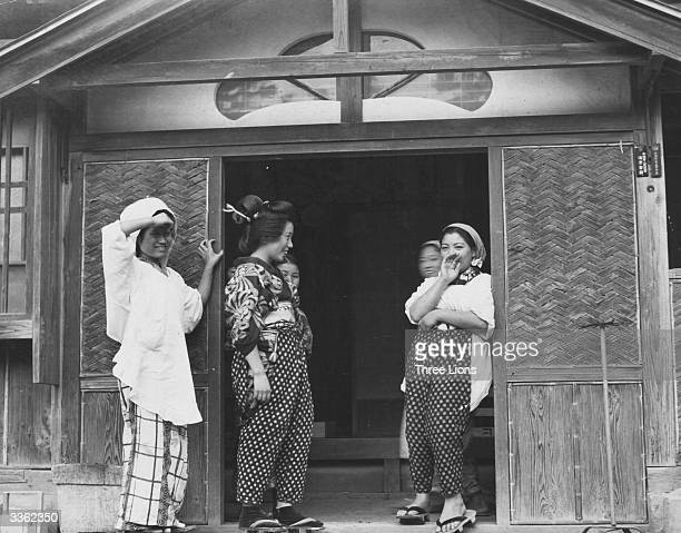 A group of country Geisha and maids in a rural town The spotted overalls they wear for protection when working in the fields or about the house are...