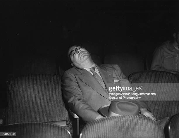 A man sleeping in his seat at the cinema Taken with infrared negative Photo by Weegee/International Center of Photography/Getty Images