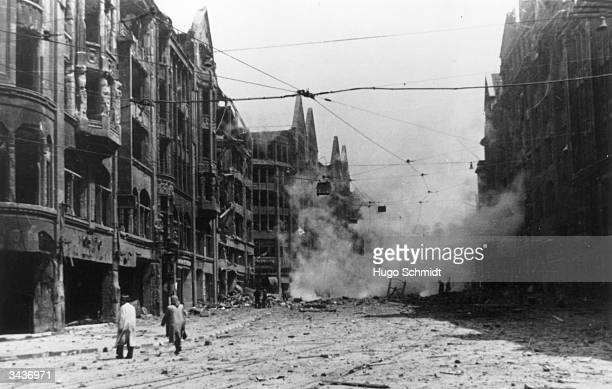 A street in Hamburg with smouldering debris and gutted buildings after a bombing raid in World War II