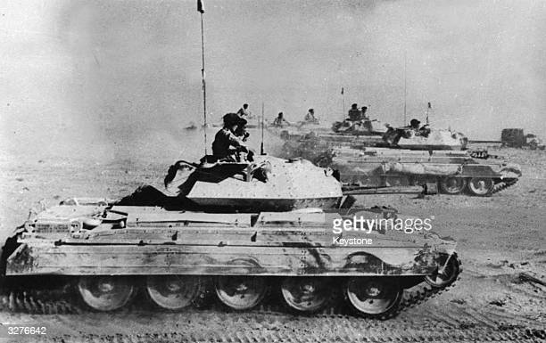 British Crusader tanks mounted with sixpounder guns moving in pursuit of Rommel's retreating forces during the Eighth Army's big push across Libya