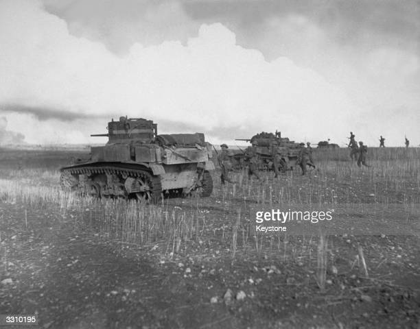 British troops advancing supported by American tanks on the Tunisian front
