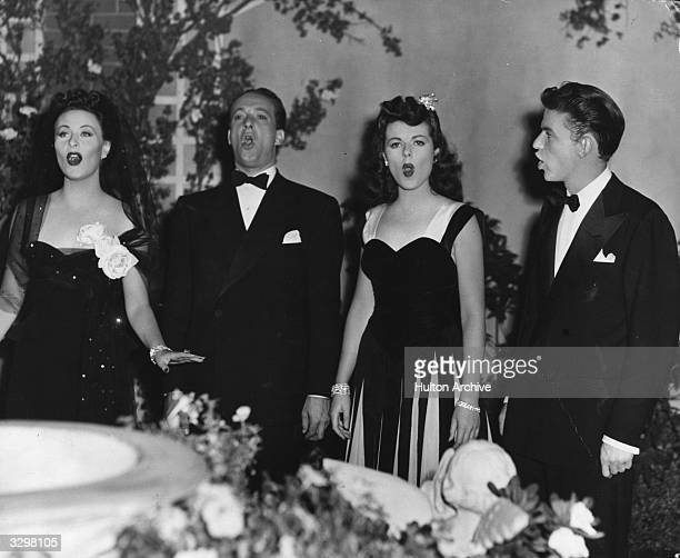 Frank Sinatra the actor and vocalist stands by Michele Morgan the French leading lady Barbara Hale the American leading lady and Victor Borge They...