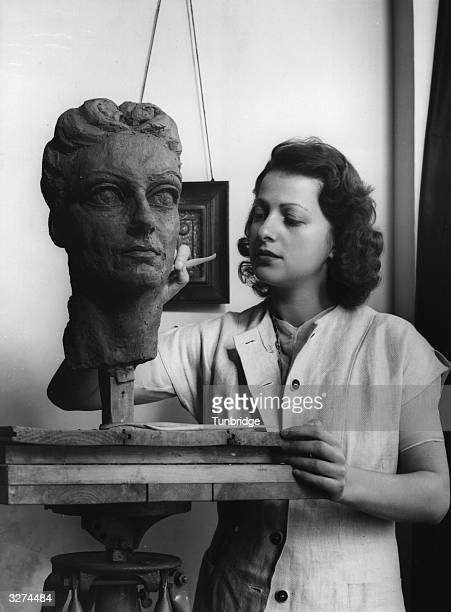Fredda Marshall nee Brilliant the sculptor and wife of the film theatre and TV producer Herbert Marshall is at work in her studio