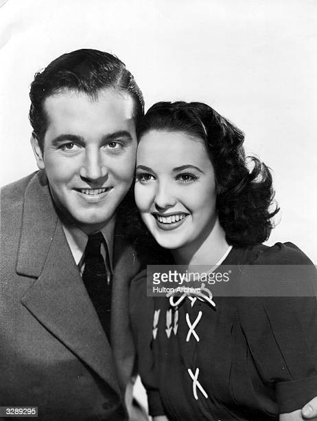 John Payne who was once a wrestler became a general all purpose leading man playing mainly in westerns and musicals He is cuddling up with Linda...