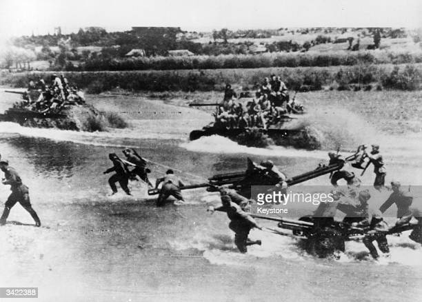 Soviet artillery and tanks force a river crossing in advance towards L'vov, also known as L'viv, in the Ukraine.