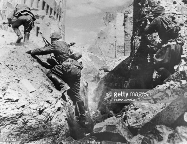 Soviet troops climb out of a trench during the Battle of Stalingrad World War II