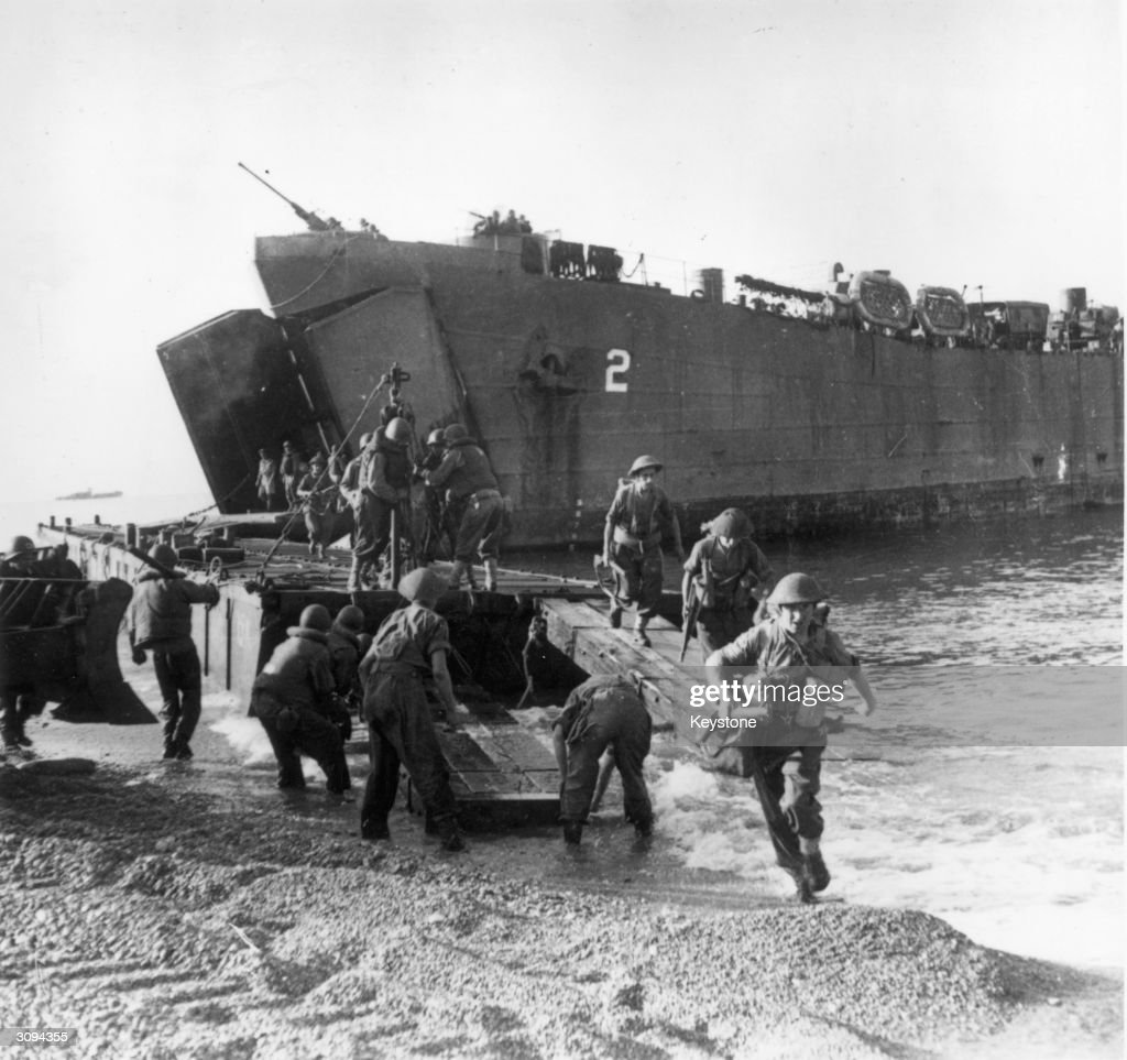 Troops coming ashore from a landing craft during the Salerno landings in Italy.