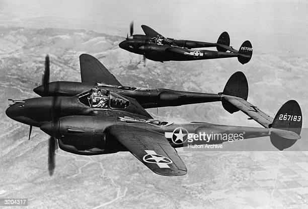Two Lockhead P38 Lightning aircraft fly on the Pacific Front during World War II