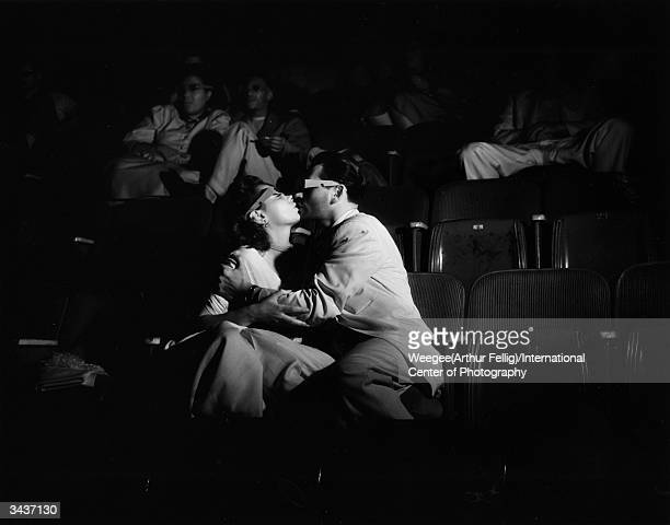 Two lovers kissing during a 3D movie at the Palace Theatre Taken with infrared negative Photo by Weegee/International Center of Photography/Getty...