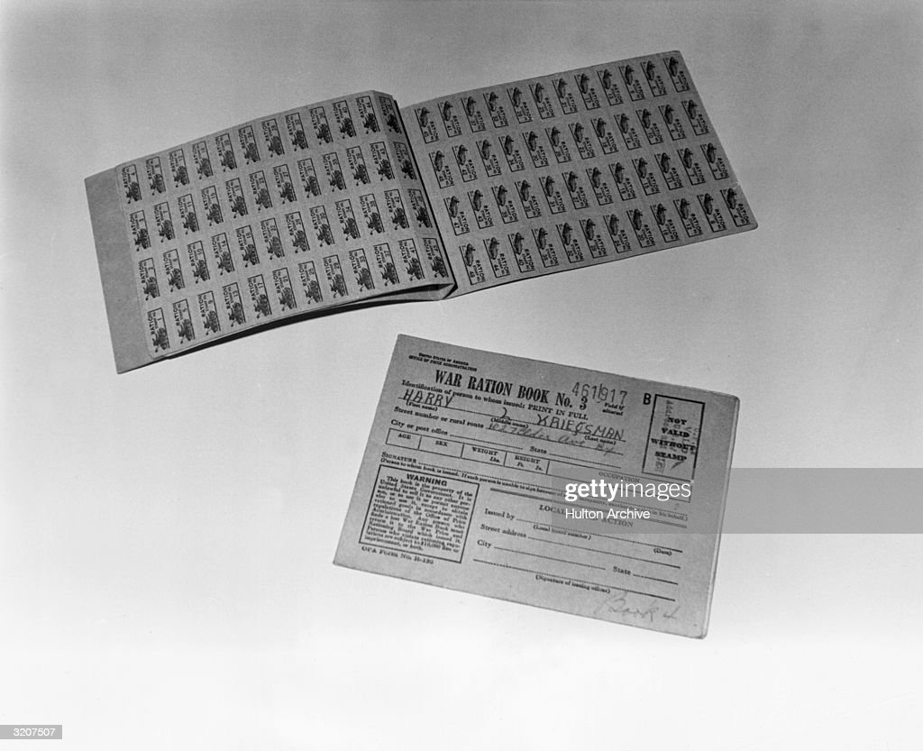 Two United States war ration books of stamps, World War II (1939-1945).