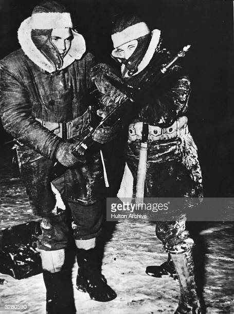 Two young American soldiers stationed in Iceland during World War II are dressed in heavy winter wear against the bitter cold