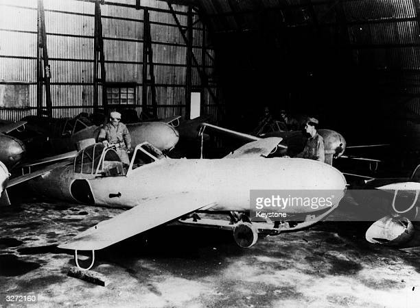 US army personnel examine a Kamikaze plane which they found at a Japanese base that had been overrun by American troops The name of the plane is...