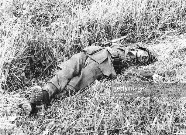 A dead soldier from a horsedrawn German battery which was hit lying on the side of the road