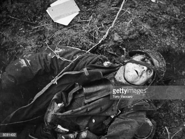A German machinegunner lies dead in a field after being struck in the eye by a bullet World War II