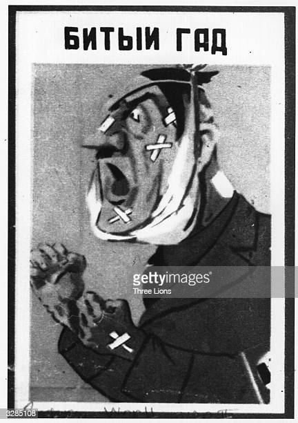 A Russian poster and caricature of Adolf Hitler