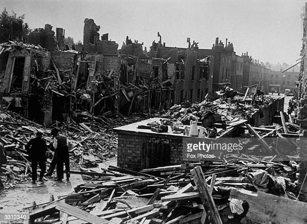A scene in a street in Islington London showing a row of houses destroyed by flying bombs whilst the street shelters remained standing