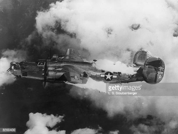 A US Airforce B24 Liberator bomber goes down in flames in a raid over Austria during World War II The American Airforce photographer who took the...