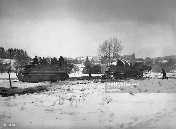 After a battle lasting 36 hours, the Allied troops captured the key village of Samree, east of La Roche, Belgium, on a ridge which looks across 9...
