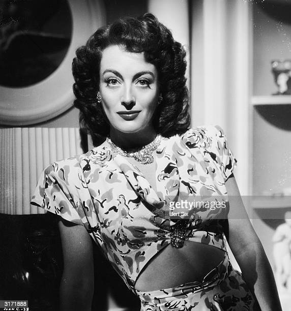 American film actress Joan Crawford wearing a patterned blouse worn high to expose her midriff at the time of her starring role in 'Mildred Pierce'...