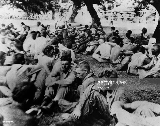 American prisoners of war held by the Japanese at Bataan Here they are herded together prior to continuing the march of death during which 67000...