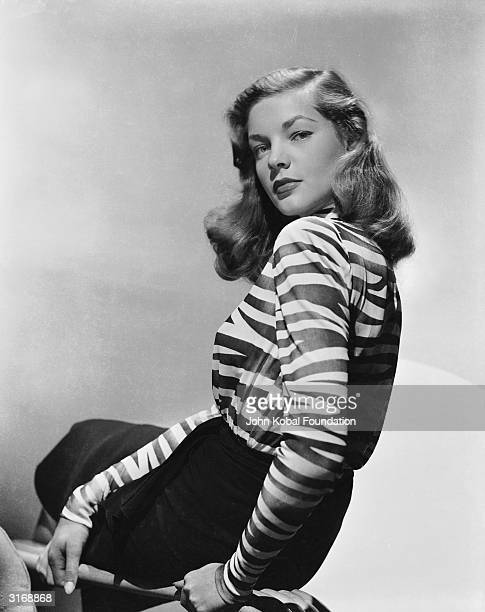 American screen star Lauren Bacall whose successful film career spans more than fifty years wearing a zebra striped blouse