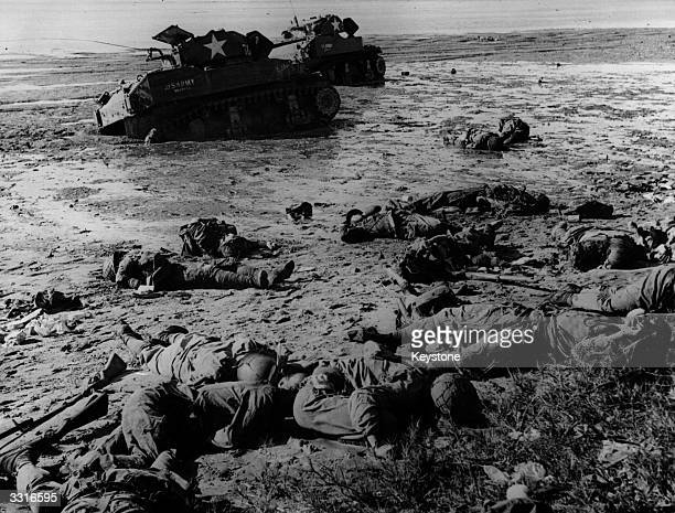 Dead Japanese troops litter the beach at Tan Apag harbour Saipan after their futile counter attack against the US 27th Infantry Division