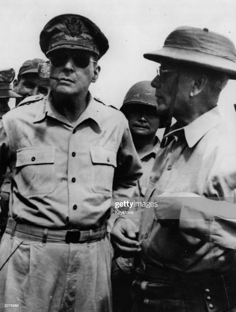 General Douglas MacArthur (1880 - 1964) American soldier with President Sergio Oslena of the Philippines, who is wearing a life-belt after landing to re-establish the Philippino Government.