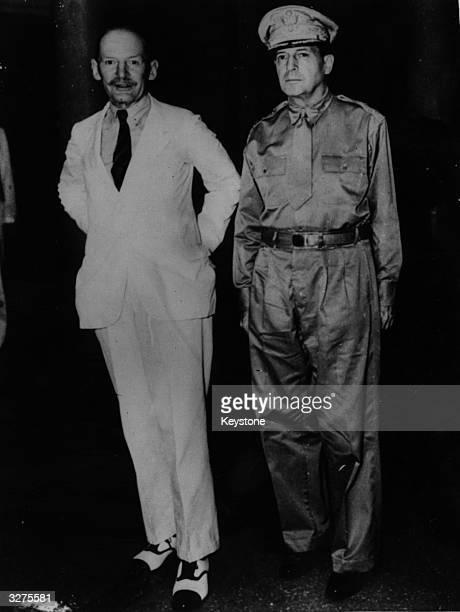 General Douglas MacArthur meeting HRM Air Marshall Robert BrookePopham the British Commanderin Chief in the Far East in Manila for the first time