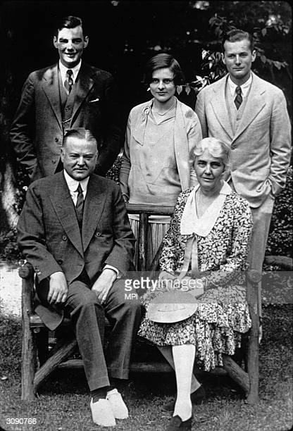 Herbert Hoover , the former President of the United States with his wife, sons and daughter-in-law.