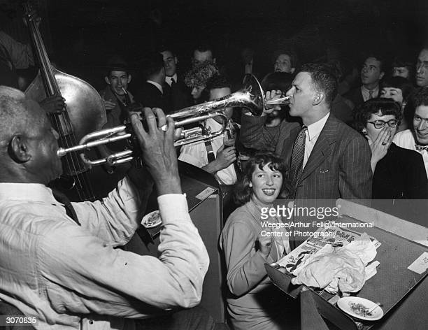 Members of the audience listening to a jazz band playing 'Bell Bottom Trousers' at Stuyvesant Casino Photo by Weegee/International Center of...