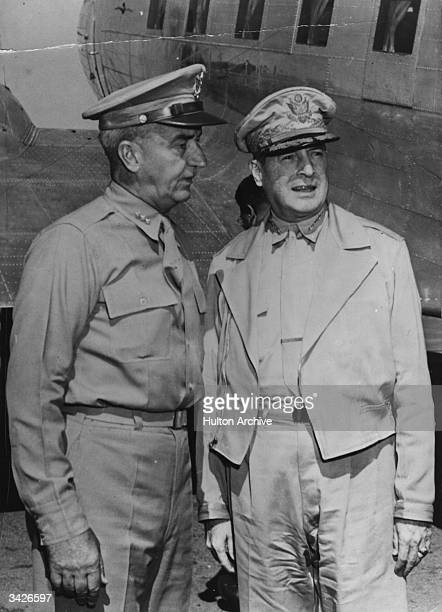 US general Douglas MacArthur Commander in Chief of Allied Forces in the Southwest pacific area talking with Lt General Robert L Eichelberger during...