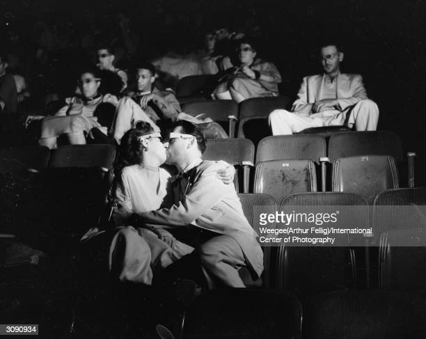 A couple wearing 3D glasses kissing during a show at the Palace Movie Theatre Photo by Weegee/International Center of Photography/Getty Images