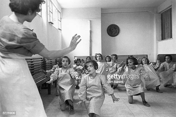 A group of girls in a dance activity class at a convent in Rome where they are cared for by nuns They are part of a group of children who were...