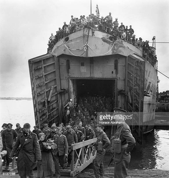 Landing Craft Tank carrying German prisoners of war arrives at a British port from France.