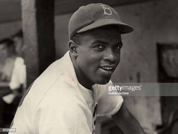 Portrait of the Brooklyn Dodgers' infielder Jackie Robinson in uniform.