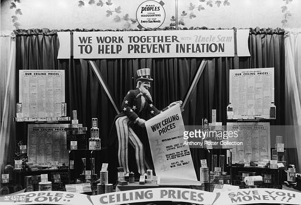 Store display with an Uncle Sam doll, anti-inflation signs, and store goods during World War II. A banner above the doll reads, 'We work together...