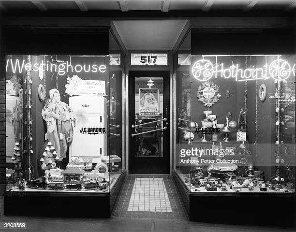View of a hardware store's Christmas window display, 1940s.