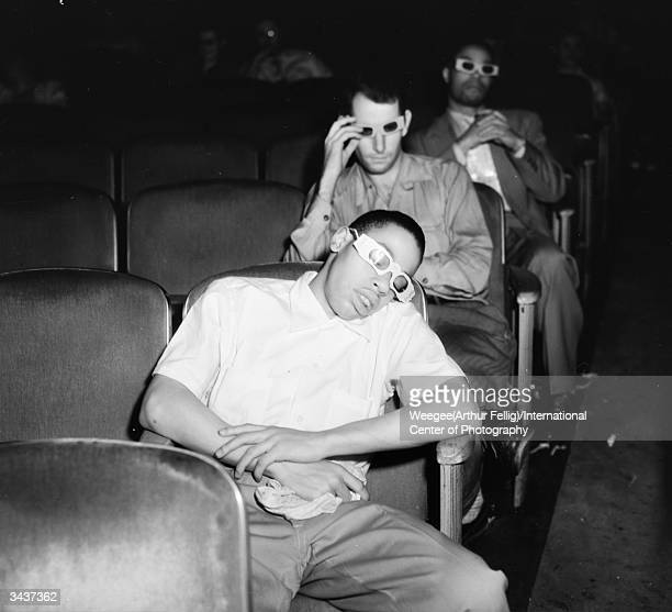 A youth asleep in a New York cinema wearing 3D glasses Taken with infrared film Photo by Weegee/International Center of Photography/Getty Images